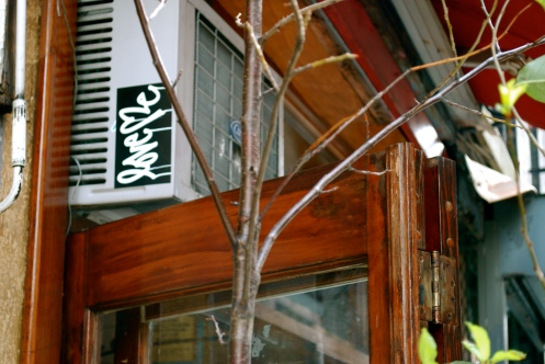 Sticker Above Door in East Village 1